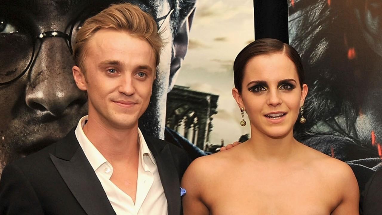 Tom Felton ao lado da atriz Emma Watson.